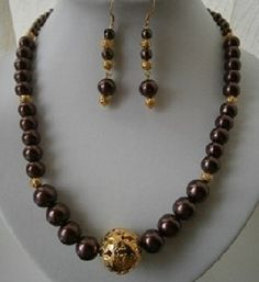 """20 """" BROWN AND GOLD GRADUATED BEADED NECKLACE AND EARRING SET £12.00"""