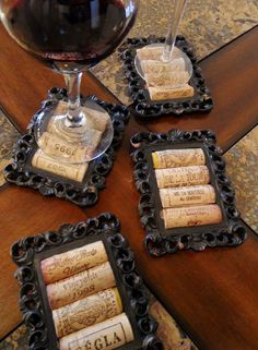 DIY Cork Coasters Using Small Picture Frames These coasters are black, sexy and one of a kind! The corks are placed in the middle of a rustic and vintage looking frame and would look perfect in any wine decorated room.