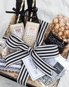 PARTY BOX  A chic welcome or thank you gift. Includes 2 bottles of bubbly and an assortment of treats made in Toronto. All black, white and gold.