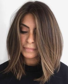 Tousled Streamlined Brown Lob It's easy to wear your long bob cut. Part your medium-length hair a little off-center and tousle to bring out the layers. The subtle highlights draw attention to the feathery ends, and the inverted shape gives it a classic Long Bob Haircuts, Long Bob Hairstyles, Trending Hairstyles, Medium Hair Styles, Curly Hair Styles, Long Bob Cuts, Longe Bob, Lob Hairstyle, Hairstyle Ideas