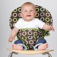 Totseat: works on almost any chair and squishes up small enough to fit in a diaper bag.
