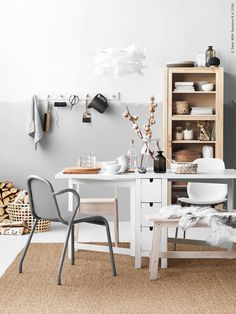 Dining room inspiration with half-painted rough rolled light grey, natural materials and hanging utensils. | styled by Pella Hedeby for Ikea