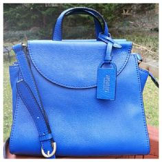 """HPKate Spade Mini A Satchel - RARE Mini structured satchel from the discontinued Saturday line in stunning electric blue. Pebbled leather, top handles, detachable crossbody strap. Two outer compartments with snap flap closure, center compartment with zip closure and inner slip pocket. Height 8"""", width 9.5"""", depth 5"""", strap drop 22.5"""" (adjustable), handle drop 3"""". Only used twice, EUC. kate spade Bags Satchels"""