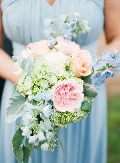 Bridesmaids carried bouquets of garden roses, hydrangeas, delphinium, eucalyptus, boxwood #weddingbouquet