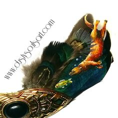 Check out this item in my Etsy shop https://www.etsy.com/uk/listing/507032867/otter-feather-vintage-brooch-handpainted