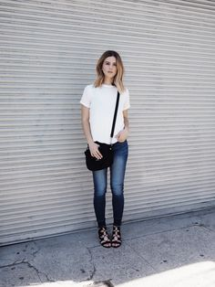 Style Blogger, Michelle of Take Aim wearing the perfect off-duty outfit. Michelle is wearing our Daisy Scalloped Blouse, Two-Toned Skinny Jeans and our Izabel Lace-Up Sandals. Available on www.norestforbridget.com.