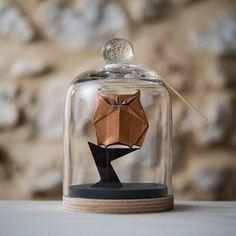 Origami animals in glass