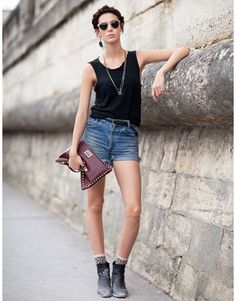 Street Style  Ruby Aldridge is your quintessential rocker chick in cut off shorts, dirty black boots and a studded handbag.