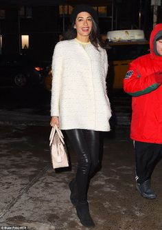 Taking a bite out of the Big Apple: Amal Clooney was spotted out and about in New York City on Friday night