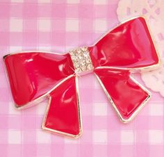Extra cute and kitsch hot red enamel and metal bow. These flat back resin #cabochons are perfect for all kinds of #kawaii crafts. #DIY