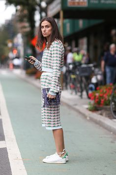 I LOVE the set and I love how she tied the laces around her ankles!  #stylingtricks Best Sneaker Street Style 2014 | POPSUGAR Fashion