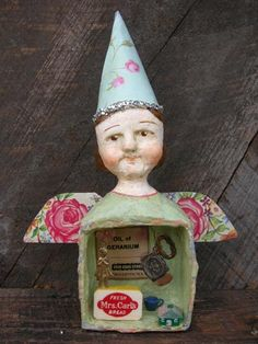 """Carol Roll......this sweet and charming """"Tribute To Mothers"""" paper mache mixed media sculpture."""