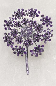 RENÉ BOIVIN Diamond and Amethyst Brooch, ca. 2005  Of umbel flower design, decorated with circular-cut amethysts in various shades of violet, enhanced with a circular-cut diamond accent, mounted in oxidized 18K gold, diameter 7.5 cm. Signed 'René Boivin,' numbered 1/1 and dated.  With French assay marks