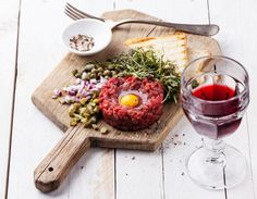 Beef tartare with capers and fresh onion on board with wine. Photograph тартар by Natalia Lisovskaya on Gourmet Recipes, Beef Recipes, Cooking Recipes, Recipies, Tartare Recipe, Meat Love, Cheese Snacks, Food Menu, Food Inspiration
