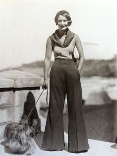 "18 yr old actress Corinne Luchaire taken August 1939 in Deauville, France // She is wearing a trouser suit by Freddy & a coat by Jacques Heim (1899-1967). Heim had launched his sportswear boutiques in Biarritz & Cannes in 1937, only two years before the photo was taken. Luchaire is therefore sporting one of the ""in"" designers of the day. // Corinne Luchaire enjoyed short-lived film stardom."
