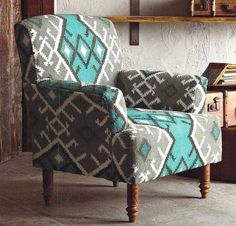 Enjoy this bright blue, mossy green and cool grey Bibi Kilim Chair. The graphic design adds character to this specially tailored chair. Heavy-weight cotton kilim covers a hardwood frame and natural wo