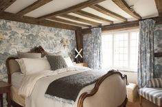 The french-style upholstered bed dominates the bedroom