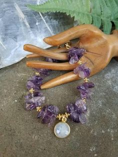 Amethyst Crystal Bracelet with Moonstone Charm. Fancy Toggle Clasp Design. Energy Jewelry. Handmade by Little Miss Gypsy. ~*~ GIFT READY ~*~ Ships same or next business day. Spiked Amethyst beads mixed with gold spacers and a Rainbow Moonstone charm make a charming duo in this