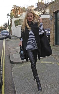 Kate Moss street style combining two fundamental wardrobe elements, a cape and leather pants. There is a reason she is a huge style icon.