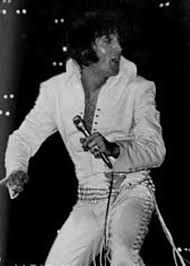 """This belt Elvis wore also with the """"White Cossack Top"""" aka """"White Pearl"""" or """"Neck Cords Suit"""". He wore it in 1972 with a rare two-piece-suits."""