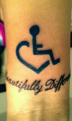 """Wheelchair heart tattoo with text """"beautifully different"""" on the wrist 
