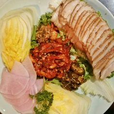 Most famous for its version of bossam: boiled pork belly you wrap up into leaves with raw garlic, sliced chiles and a salty condiment made from tiny fermented fish.