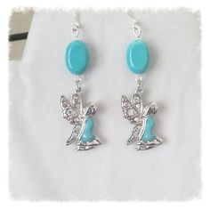 Gemstone Dangle Earrings with Turquoise Howlite and Pixies or Angels by Earthcentricity on Etsy #group2020