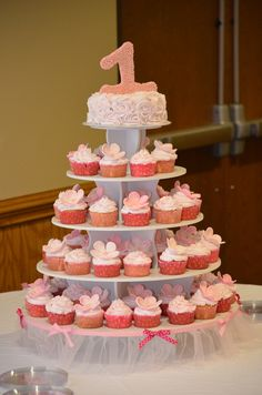 1st birthday pink cupcake stand and cake #pink #cupcakes