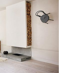 Vertical built-in firewood shelving (don't much care for the rest of the design…