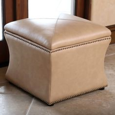Featuring a unique camel coloration, this useful ottoman works double duty as both a storage container and a decorative piece of furniture. Allow this ottoman to create a truly unique atmosphere in your home.