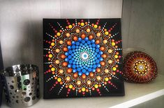 This is a gorgeous painting- so vibrant, colourful and tactile mandala! I painted this mandala with acrylics on canvas in point to point technique. The painting is protected from UV rays and dust with coats of satin varnish. The back is signed for originality. No frame! Measures