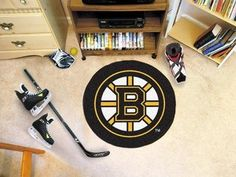 "Fan Mats 10495 NHL - Boston Bruins 29"" Diameter Puck-Shaped Area Rug by Fanmats. Save 40 Off!. $19.85. Accent your den or fan cave with this NHL® puck-shaped floor mat from Fanmats®. It features a durable nylon construction, boasts non-skid Duragon® latex backing for safety, and is Chromojet-painted with the team logo."
