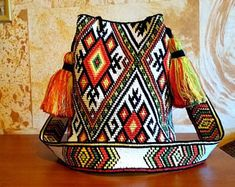 Folk Embroidery Patterns Crocheted Multi-Colored mochila bag - Pattern of Ukrainian folk embroidery - wayuu tecnique crochet- crossbody bag, boho bag - Embroidery Online, Folk Embroidery, Embroidery Patterns, Crochet Patterns, Mochila Crochet, Bag Crochet, Crochet Purses, Tapestry Bag, Tapestry Crochet