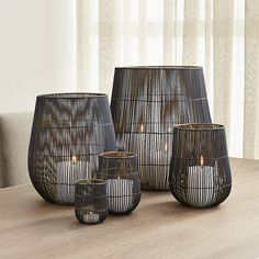 Kent Wire Candle Holders is part of Home Accessories Candles Living Rooms Shop Kent Wire Candle Holders Delicate wire cage shelters candles in twotoned iron Black exterior accentuates the delica - Candle Holders, Crate And Barrel, Lantern Candle Holders, Hurricane Candles, Wire Candle Holder, Candle Lanterns, Living Room Candles, Organic Interiors, Candle Decor