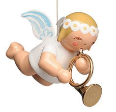 """Wendt and Kühn Small Suspended Angel with French Horn. 1"""" tall. New 2014. With a Wendt and Kühn Presentation / Gift Box. Wendt and Kühn of Grünhainichen, Germany, a """"Toymakers Village""""- since 1915. Imaginative, unique, elegant, and delicate figurines from a traditional workshop. Visit www.mygrowingtraditions.com for this and a full selection of Wendt and Kuhn ornaments and figures."""