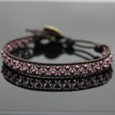Checkerboard Leather Wrap Bracelet Kit - Purple (Single), This substantial variation on the Leather Wrap bracelet features a stack of Swarovski pearls and Czech glass with purple metallic leather. Finished bracelet is just over 1/4 inch wide and is long enough to wrap once around up to an 8 inch wrist. Exclusive to Bead World Inc.