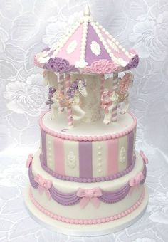 Carousel christening cake, 2 tier cake with edible decoration