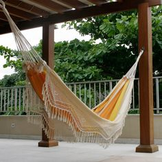 Features:  -Material: 100% Cotton.  -Brazilian beach theme.  -Dry cleaning recommended.  -Hanging accessories not included.  Product Type: -Tree hammock.  Hammock Material: -Cotton.  Hammock Color: -O