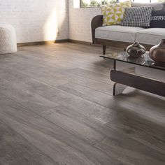 the living room is warmer with dark wood floor tiles Wood Parquet, Wood Tile Floors, Dark Wood Floors, Wooden Flooring, Basement Renovations, Home Remodeling, Parquet Leroy Merlin, Home Decor Kitchen, Home Staging