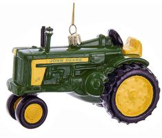 Add a tractor to your Christmas tree! The John Deere brand is a well known brand throughout the United States. This John Deere Tractor Glass Ornament measures approximately x x 2 Ages 14 and up. Glass Christmas Decorations, Holiday Ornaments, Glass Ornaments, Christmas Tree, Toyota 4runner, Toyota Tacoma, Ups Shipping, Free Shipping, Welding Rigs