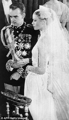 Imitation game: Both Nicky and Grace donned long-sleeve lace gowns featuring high-necks when they married James Rothschild and Prince Ranier III (pictured), respectively