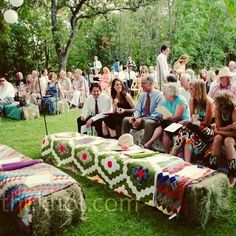 Potential ideas for ceremony seats and backyard seating in general. some hay bales and some folding chairs.
