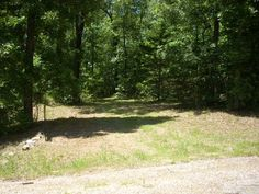 Stunning views from this 7.65 Acres when you thin the trees to suit you. Views up and down the White River as well as beautiful Ozark hills. Reasonable restrictions, paved street, culvert in meandering drive in. Will need well & septic in Mountain Home AR