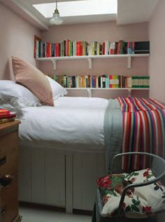 Skylight, high bed, books easily accessible, rainbow stripey blanket...what's not to love?!