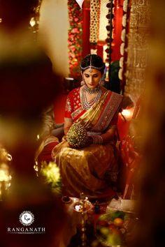 South Indian b ride. Red and gold silk kanchipuram sari.Braid with fresh jasmine flowers. South Indian Weddings, Big Fat Indian Wedding, South Indian Bride, Kerala Bride, Indian Bridal Sarees, Indian Bridal Wear, Indian Wear, Desi Wedding, Saree Wedding
