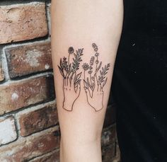 Hand with flowers line minimalist tattoo