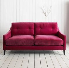 The jewel tone trend isn't just a fad! This fuchsia love seat is so chic and cozy looking. - #redbook #TrueBlood.