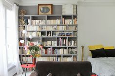Being in Paris Part I. The Apartment. Love grey shelvng...light floors & how simple and sweet this place is.