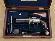 "Exceptional original English-cased pepperbox pistol by Charles Jones of 26 St. James St. London. Engraved with cast metal alloy frame, numbered ""261"", case-hardened barrels, blued mounts, deluxe English style case with maker's label in lid. The pepperbox measures 8-3/4"" overall with 3-3/8"" barrel group of .41 caliber, six shots."
