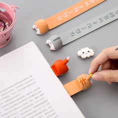Keep track of reading progress through your favorite book with these hilarious animals chubby butt bookmarks! Each bookmark looks as though an animal is burrowing into the page where you last left … Book Markers, Page Marker, Milkshake, Japanese Language School, Cute Bookmarks, Cute Hamsters, Kawaii Accessories, Kawaii Stationery, Cartoon Dog